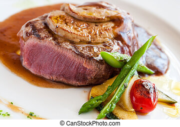 Grilled beef filet with foie gras. - Close up of beef steak...