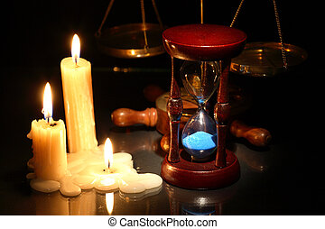 Hourglass And Candles - Vintage ctill life with hourglass...