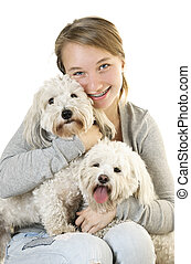 Teen girl with cute dogs - Pretty teenage girl holding two...