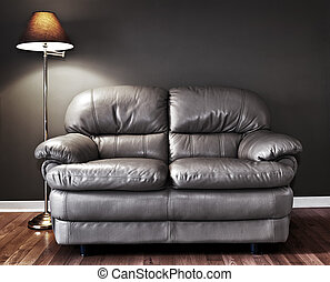 Couch and lamp - Leather love seat and floor lamp against...