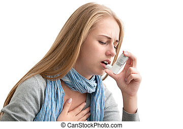 suffering from asthma - Young woman using an asthma inhaler...