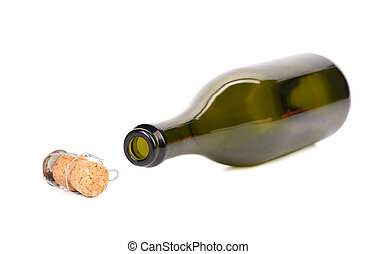 Empty bottle of champagne and muzzle with cork.