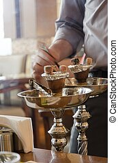 Shisha preparation - Preparing the shisha, aka nargile or...