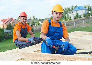 Carpenter workers on roof - construction carpenters workers...