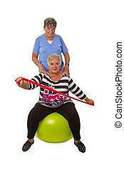 Two female senior woman exercises