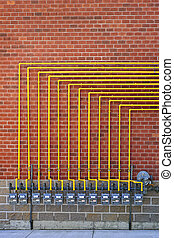 Gas meters on brick wall - Row of natural gas meters with...