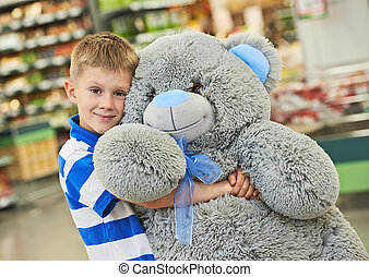 Little boy with bear toy - Little child boy with big plush...