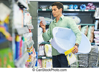 Young father shopping - Ypong father man shopping things for...