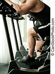 jim bicycle fitness - not recognisable young man working out...