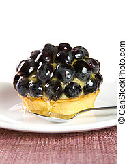 Tarte - Vanilla and grape tarte on a plate