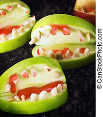 jaw with teeth of apples and nuts for Halloween