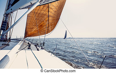 Sailing ship yachts with white sails in a row