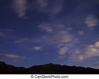 Night in the mountains Time Lapse 4x3 - Stars hide the...