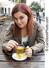 young woman drinking tea