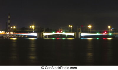 opening drawbridge at night in St Petersburg Russia -...