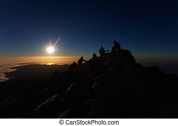 climbers at sunrise