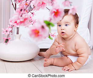 baby at home - cute baby boy at home on the floor with a...