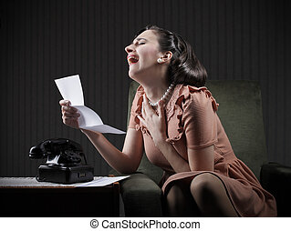 Bad News - Young woman reading a letter crying desperate