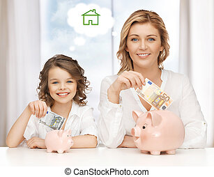 mother and daughter saving money - home, real estate and...