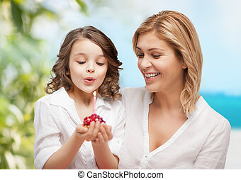 happy mother and daughter - family and holidays concept -...