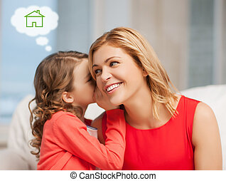 mother and daughter with eco house - home, real estate and...
