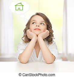 girl dreaming about the house - family and new home concept...