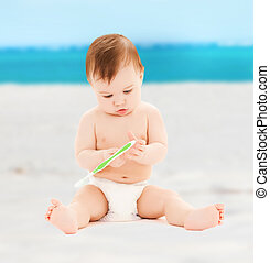 little baby playing with toothbrush - stomatology and child...