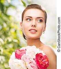 woman with diamond earrings and flowers - holidays, beauty...