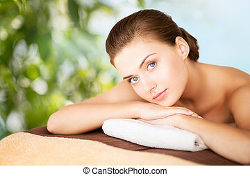 woman in spa - beauty, holidays and spa concept - woman in...