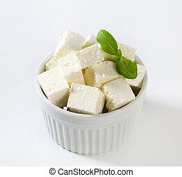 Diced feta cheese in ramekin