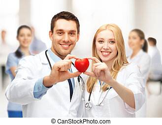 cardiologists with heart - healthcare and medical concept -...