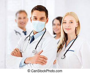 group of doctors - healthcare and medical concept - group of...