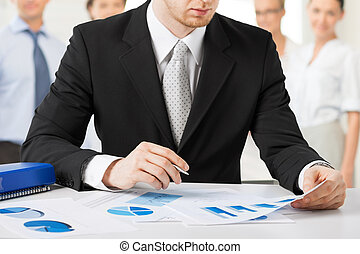 businessman working with papers - business concept -...