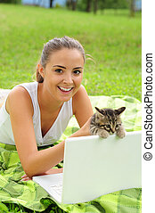 My best friend - Happy young woman with her kitty and laptop...
