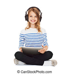 child with headphones and tablet pc - music, technology and...