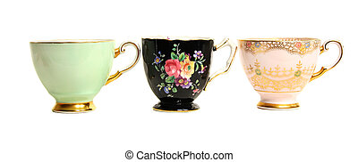 Antique Teacups Row - Three antique teacups lined up in a...