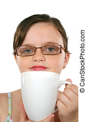 Child With Coffee Cup - Little girl with glasses looks over...
