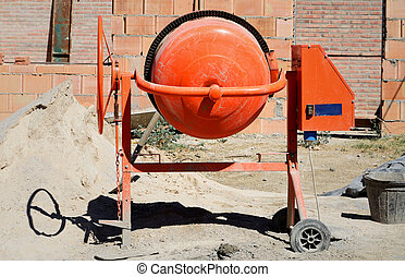 orange cement mixer at a construction work