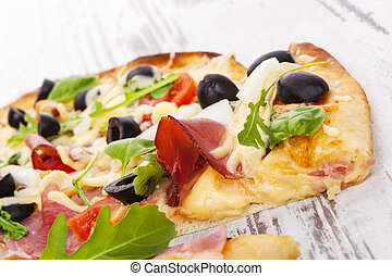 Delicious pizza detail - Delicious colorful pizza with...