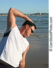 Early Morning Stretching Exercises - Man doing stretching...
