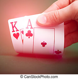 playing cards in hand on a green table casino