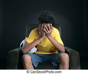 Soccer Failure - Brasilian soccer fans sitting on armchair...