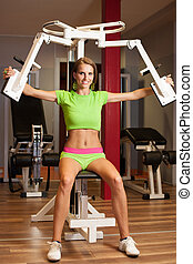 Active young woman works out in fitness