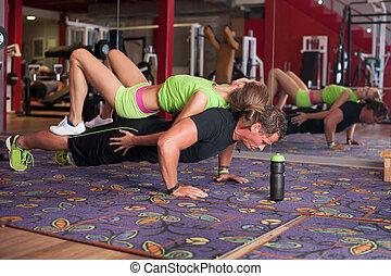 Man doing pushups with preety girl