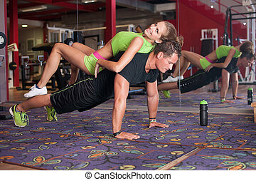 Man doing pushups with preety girl - Man doing pushups with...
