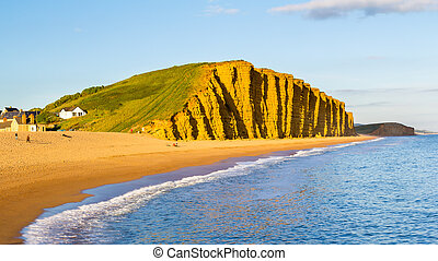 West Bay Dorset England - Evening light on the golden cliffs...