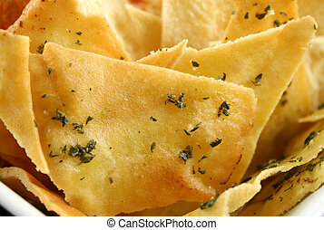 Pita Chip Background - Background of assorted baked pita...