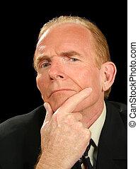 Pondering Businessman - Businessman pondering over a...