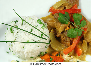 Thai Curry And Rice - Hot Thai curry with a patty of herb...