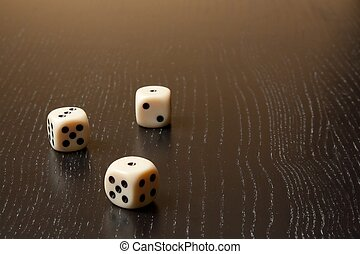 dice on old wood table - detail of dice on old wood table...